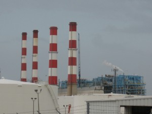 The four Florida Power and Light smokestack towers mark Port Everglades from sea or land.